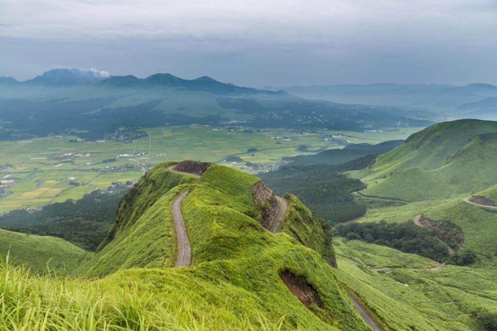 Aso volcano mountain and farmer village in Kumamoto, Japan = Shutterstock