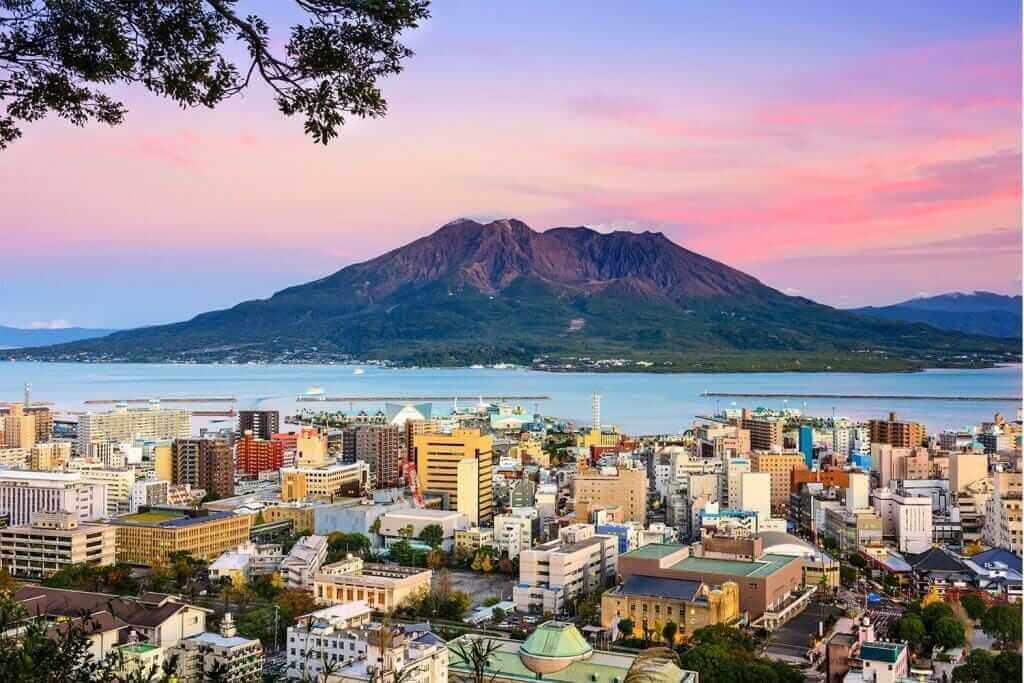 Kagoshima, Japan with Sakurajima Volcano = Shutterstock