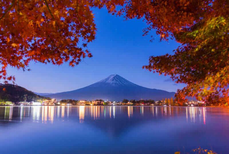Lake Kawaguchiko , Colorful Autumn Season and Mountain Fuji with morning fog and red leaves at lake Kawaguchiko, Japan = shutterstock_759980281