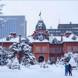 View of the Former Hokkaido Government Office in Sapporo, Hokkaido, Japan. Traveler take a photo at the Former Hokkaido Government Office in Sapporo, Hokkaido, Japan in winter = Shutterstock
