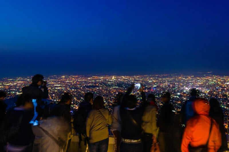 Sapporo's cityscape from mt.Moiwa = shutterstock