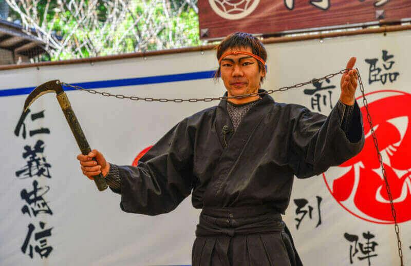 A man wearing Ninja costume and teaching at the Ninja School in Iga City, Japan