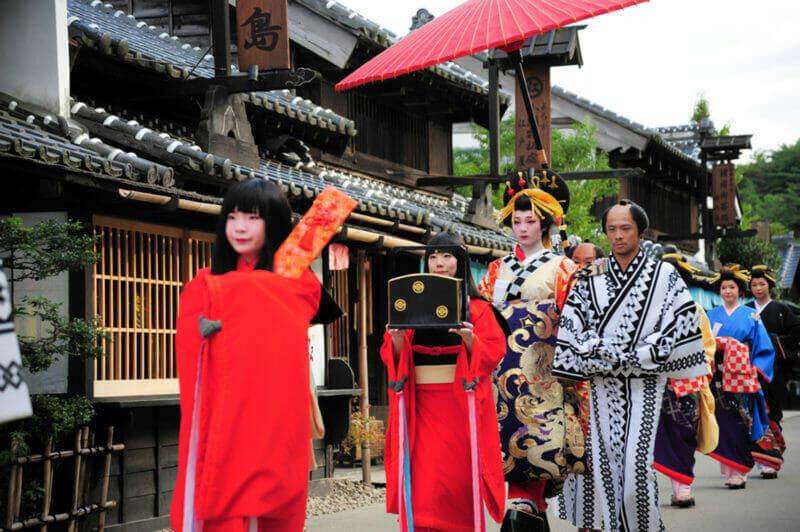 Geisha parade in Nikko Edomura(Edo Wonderland) is a history theme park recreating Japanese town life during the Edo Period 1603-1868 = shutterstock