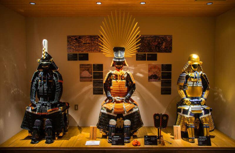 Many Samurai costumes are shown in exhibition hall inside the Samurai museum at Shinjuku = shutterstock